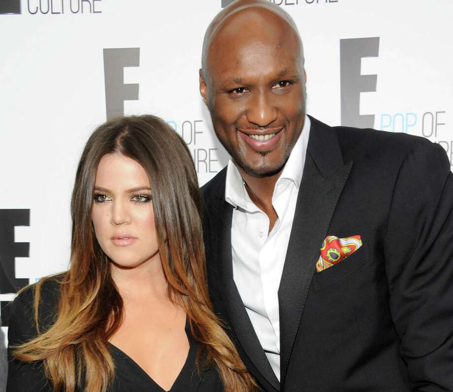 """FILE - In this April 30, 2012, file photo, Khloe Kardashian Odom and Lamar Odom from the show """"Keeping Up With The Kardashians"""" attend an E! Network upfront event at Gotham Hall in New York. A family representative says Lamar Odom has left a Las Vegas hospital and is now in the Los Angeles area to continue his recovery a week after being found unconscious at a Nevada brothel. Alvina Alston, publicist for Odom's aunt JaNean Mercer, said Tuesday, oct. 20, 2015,  that the former NBA star was transported by helicopter from Sunrise Hospital and Medical Center in Las Vegas around 5 p.m. Monday. (AP Photo/Evan Agostini, File) Photo: Evan Agostini, FRE / AGOEV"""