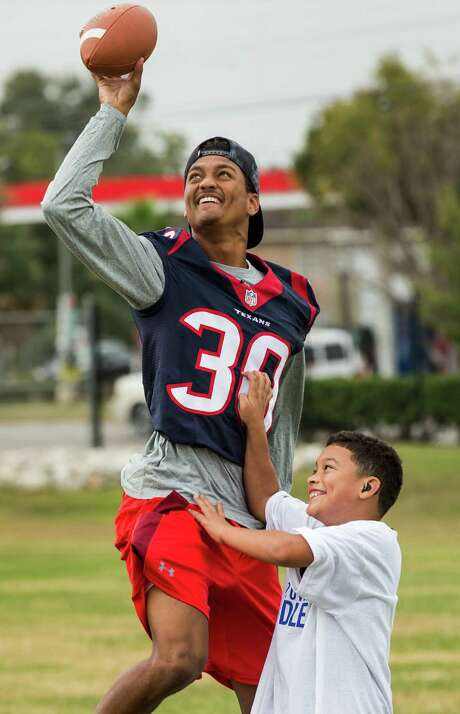 Texans cornerback Kevin Johnson has fun with Guillermo Vasquez during a Texans Home-town Huddle minicamp for Special Olympics athletes Tuesday. Photo: Brett Coomer, Staff / © 2015 Houston Chronicle