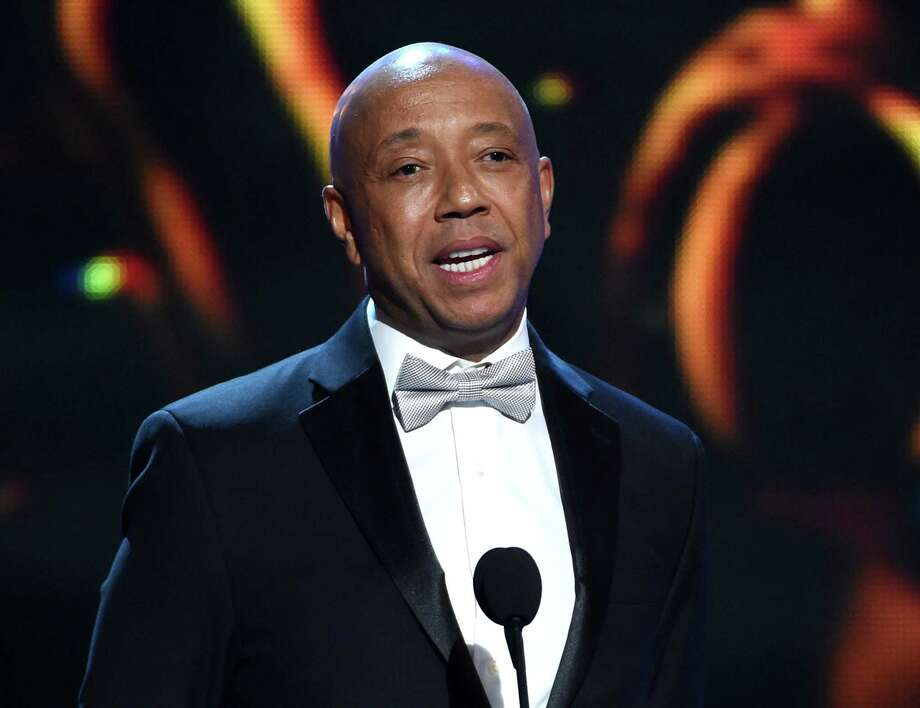FILE - In this Feb. 6, 2015, file photo, Russell Simmons presents the Vanguard Award on stage at the 46th NAACP Image Awards in Pasadena, Calif. Thousands of customers of prepaid debit cards backed by hip-hop mogul Simmons remain without access to their money more than a week after technical problems first began plaguing the cards. (Photo by Chris Pizzello/Invision/AP, File) Photo: Chris Pizzello, INVL / Invision