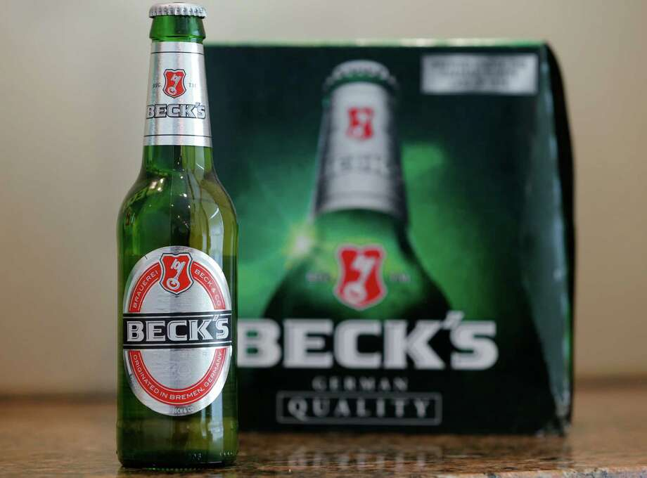 This Monday, Oct. 19, 2015 photo shows a bottle and 12-pack of Beck's beer arranged for a photo in Coral Gables, Fla. A proposed settlement of a lawsuit involving Beck's beer would give cash to drinkers of U.S.-brewed Beck's beer because of misleading packaging emphasizing the product's German origins. (AP Photo/Wilfredo Lee) Photo: Wilfredo Lee, STF / AP