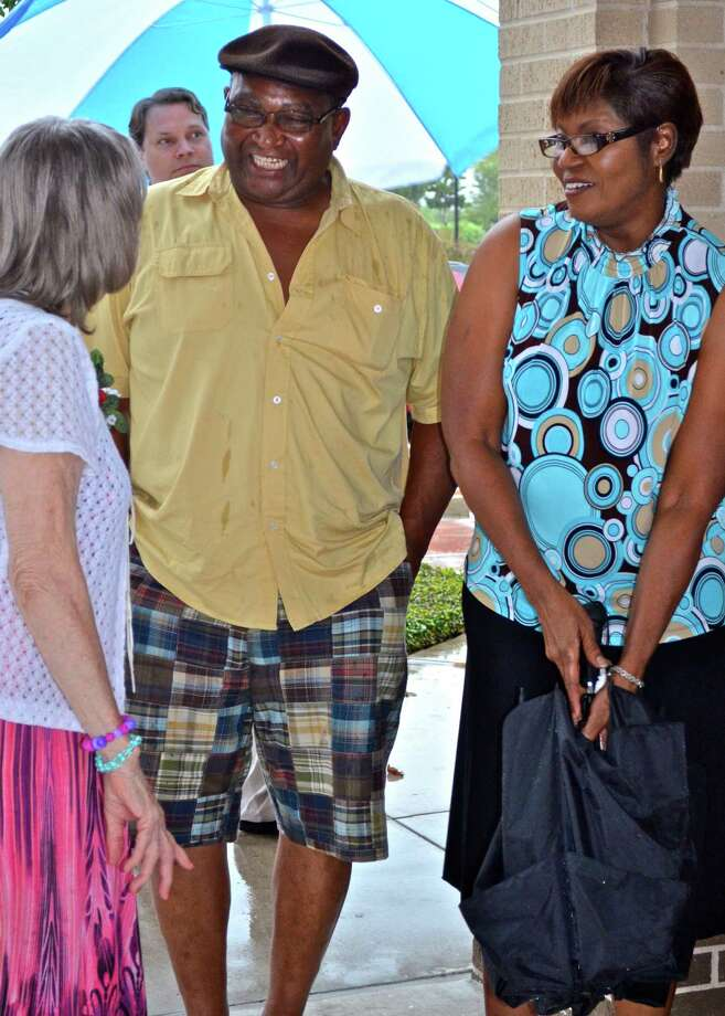 """Moise and Diane Freeman are shown at a next-door neighboré¢Ã©""""é´s wedding in 2012. Diane Freeman died when a vehicle carrying the Freemans was struck by a train at a crossing earlier this month. Moise Freeman has been hospitalized for injuries. / handout"""