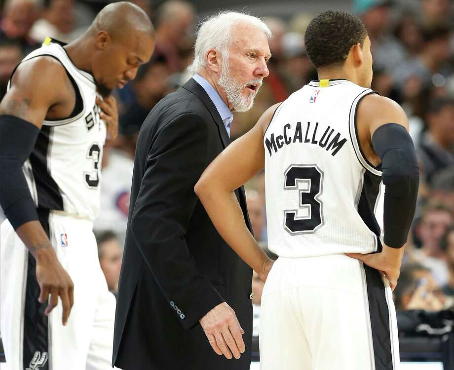 Spurs coach Gregg Popovich chats with Ray McCallum (3) during a pause against the Phoenix Suns during a preseason game at the AT&T Center on Oct. 20, 2015. Photo: Kin Man Hui /San Antonio Express-News / ©2015 San Antonio Express-News