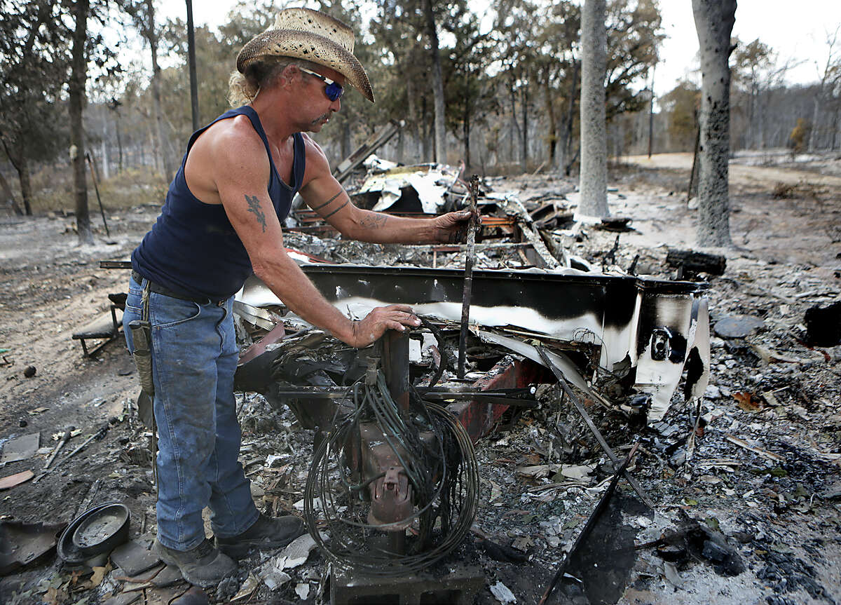 Brian Kaple, 52, looks through the ruble of his trailer home which burned on Rolling Pines Rd. Residents were allowed to return to their homes in the burned areas of the Hidden Pines Fire on Tuesday, October 20, 2015, between Smithville and Bastrop, TX.