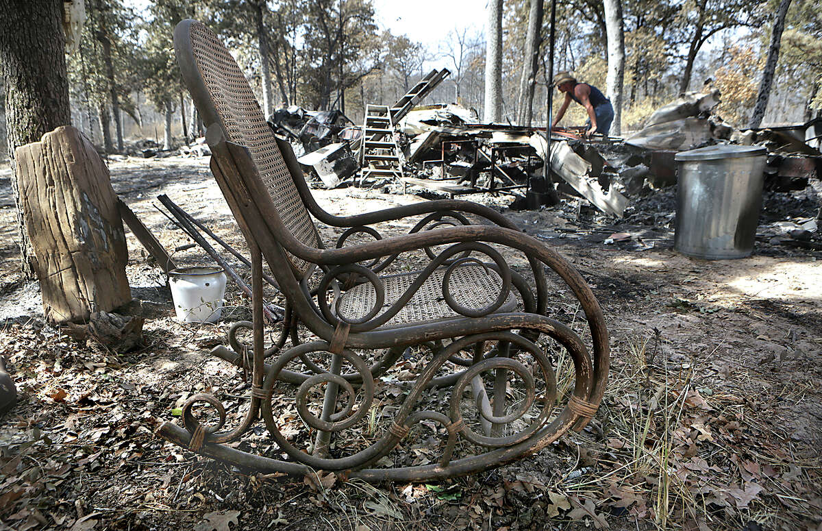 An old rocking chair is about all that survived at the trailer home of Brian Kaple, 52, who lost everything where he lives on Rolling Pines Rd. Residents were allowed to return to their homes in the burned areas of the Hidden Pines Fire on Tuesday, October 20, 2015, between Smithville and Bastrop, TX.