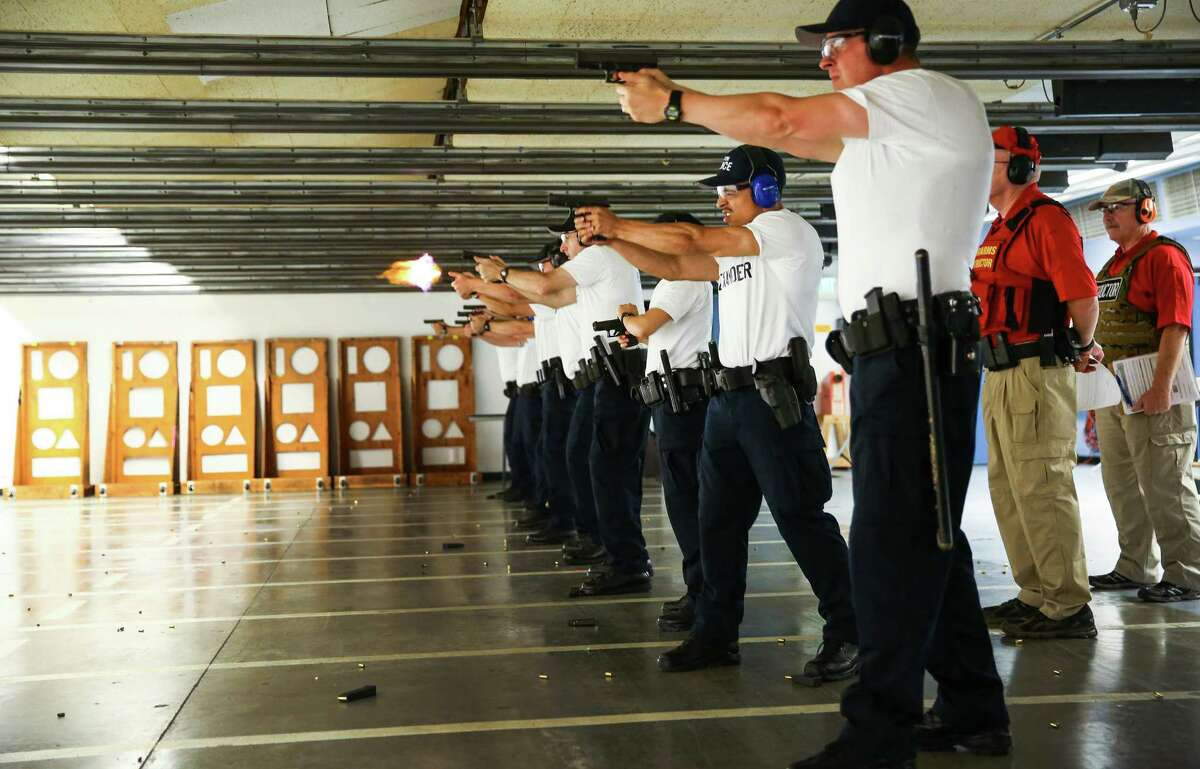 Recruits have their first experience in range with firearms instructors during the Basic Law Enforcement Academy in Burien.Photographed on July 16, 2015.