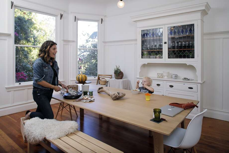 Jennine Jacob, who runs Mrs. Peasy, a party box rental company from her San Francisco, Calif., home with her son, Jasper in their dining room on Tuesday, October 20, 2015. Photo: Carlos Avila Gonzalez, The Chronicle