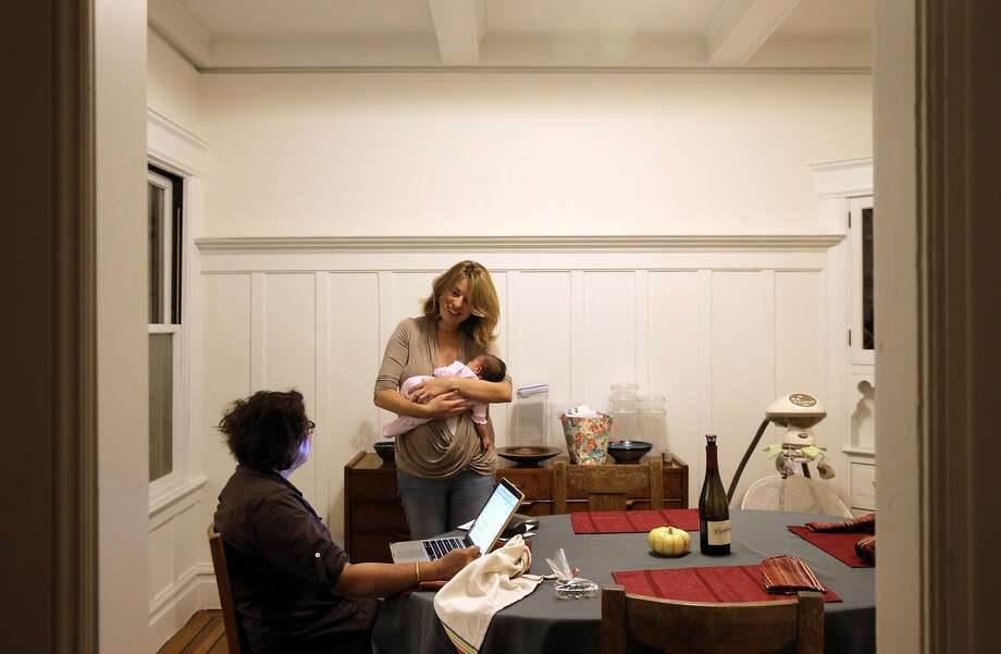 Emma Acker, with their 3-week-old daughter Maya, right, talks to her mother-in-law, Roopam Harshawat in their San Francisco, Calif., home on Tuesday, October 20, 2015. Acher and her husband, Ish Harshawat are mired in a housing battle with a tenant who refuses to leave despite the couple's family hoping to move into the apartment. Photo: Carlos Avila Gonzalez, The Chronicle