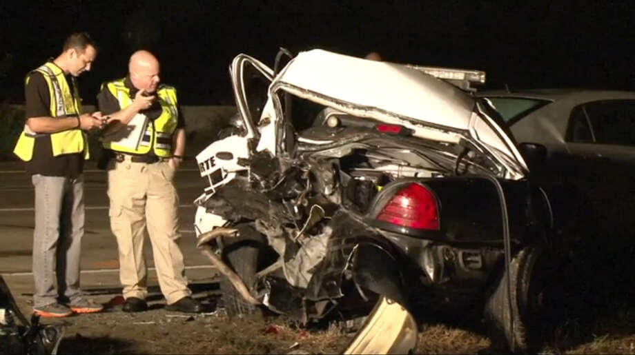 A La Porte police officer was injured Tuesday night when he was struck by a vehicle while standing outside his patrol car, conducting a traffic stop on the shoulder on Highway 146 in La Porte. Photo: Metro Video