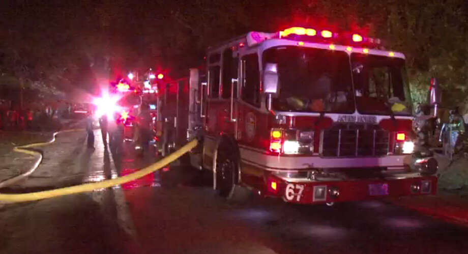 Arson is investigating how an unoccupied north Houston home cause fire early Wednesday morning. Photo: Metro Video