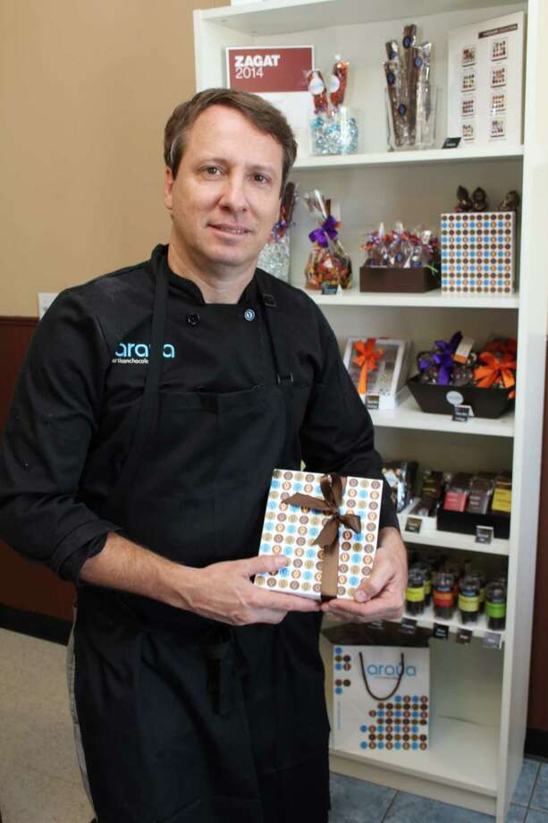 Stefano Zullian, owner of araya artisanchocolate, a Hispanic business at 1575 W. Grand Parkway South in Katy, creates and sells decorative homemade chocolates. Photo: Suzanne Rehak, For The Chronicle