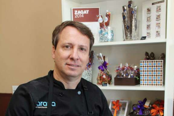 Stefano Zullian, owner of araya artisanchocolate, a Hispanic business at 1575 W. Grand Parkway South in Katy, creates and sells decorative homemade chocolates.