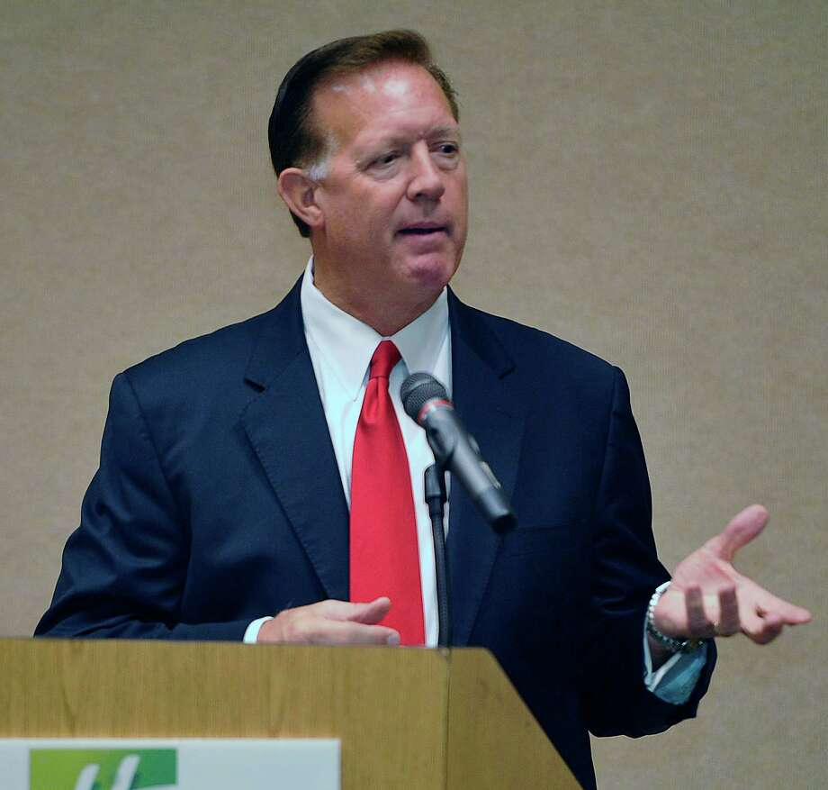 Republican Randy Weber, speaks during the presentation, talking about issues of importance to voters like health care, federal debt and whether or how to fund improvements to the Sabine-Neches Ship Channel. The Greater Beaumont Chamber of Commerce candidate forum started at 8 a.m. Tuesday morning at the Holiday Inn on Walden Road.  Dave Ryan/The Enterprise Photo: Dave Ryan