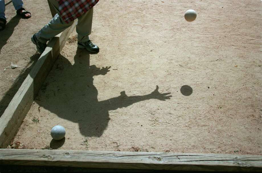 Bocce ball leagues allow participants to play a sport as well as socialize and hangout for a drink or a snack. Major League Bocce meets on Tuesdays and Wednesdays in the Inner Loop area. Photo: Karen Warren, Staff / Houston Chronicle