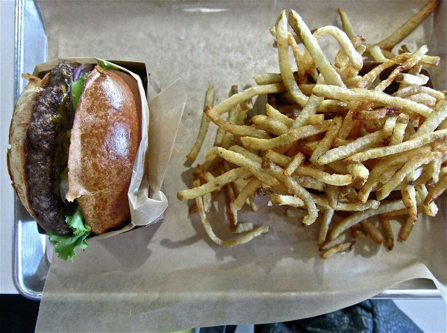 Tray service at Buff Burger, with cheeseburger and fries. Photo: Alison Cook