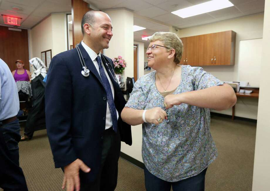 Dr. Philip Blum began treating Kari Kime, 46, immediately after a nerve test confirmed that she had Guillain-Barre syndrome. Photo: Gary Coronado, Staff / © 2015 Houston Chronicle