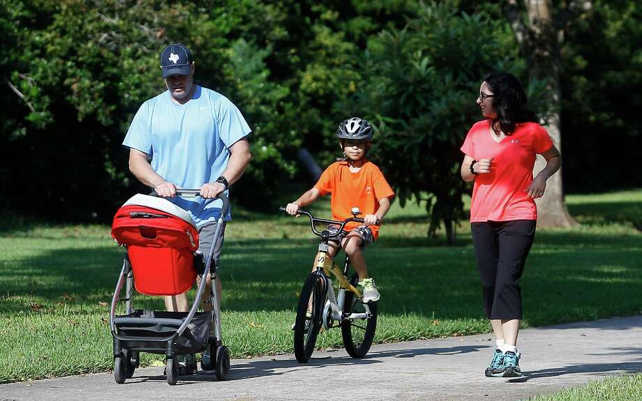John Phillips worked to lower his blood pressure by changing his diet - eating more fruits and vegetables - and getting more exercise, including getting outdoors with his wife, Erika, and son, John. Photo: J. Patric Schneider, Freelance / © 2015 Houston Chronicle