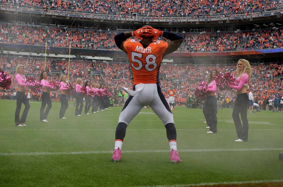 Denver Broncos outside linebacker Von Miller takes the field before an NFL football game against the Minnesota Vikings Sunday, Oct. 4, 2015, in Denver. Miller had just been fined $11,567 for a not-safe-for-work sack dance based on a skit by comedians Key & Peele. (For more examples of self-expression in sports, scroll through the slideshow.) Photo: Jack Dempsey, Associated Press / FR42408 AP