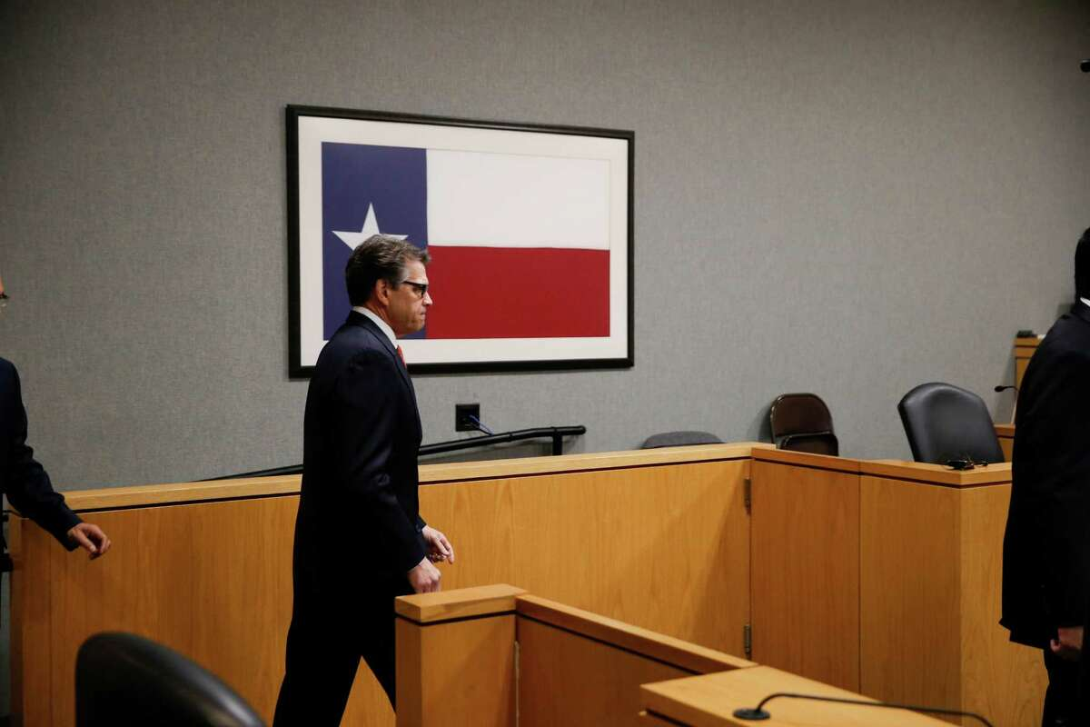 Texas Governor Rick Perry appears in Travis County Court on Thursday to answer charges in an indictment rregarding his veto of funding for the Travis County Public Integrity Unit.