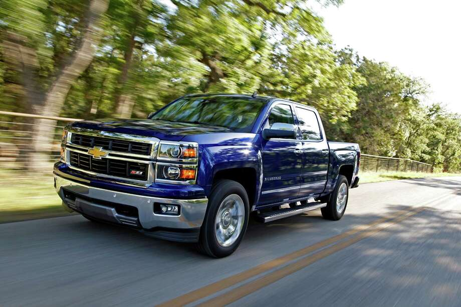 This undated photo provided by Chevrolet shows the 2014 Chevrolet Silverado. General Motors is recalling about 3,300 pickup trucks and SUVs, mainly in North America, because an ignition switch problem can make engines stall. The new recall covers 2014 Chevrolet Silverado and GMC Sierra light-duty pickups, 2015 heavy-duty pickups, and 2015 Suburban and Tahoe SUVs. (Chevrolet via AP, Tom Drew) Photo: Tom Drew, HONS / General Motors