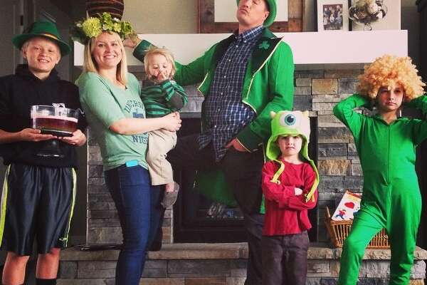 Seth King poses with his family on St Patrick's Day. King writes embarrassing late notes for his children and shares the notes on social media.