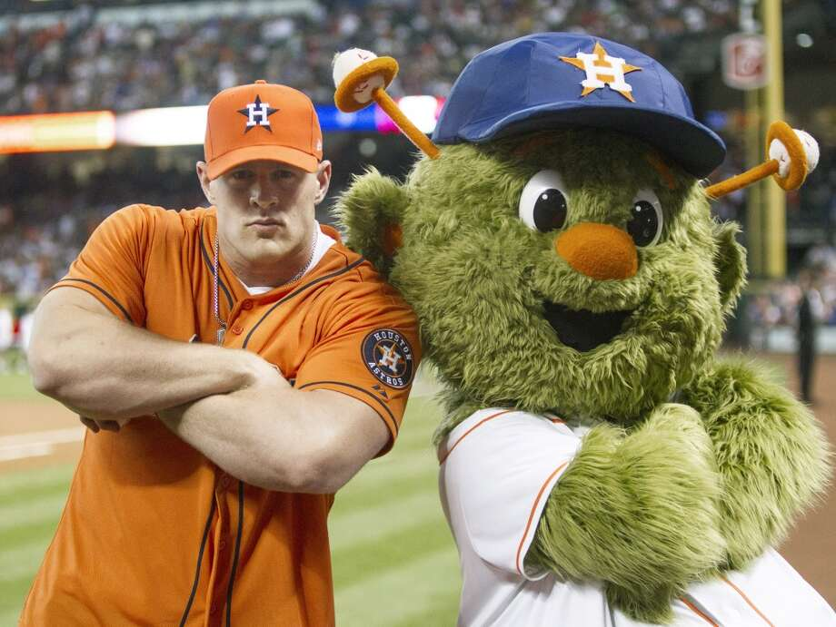 PHOTOS: A look at J.J. Watt throwing out the first pitch at past Astros gamesHOUSTON, TX - MARCH 31:  Defensive end J.J. Watt of the Houston Texans poses with Houston Astros mascot Orbit after throwing out the first pitch during opening night at Minute Maid Park as the Texas Rangers played the Houston Astros  on March 31, 2013 in Houston, Texas.  (Photo by Bob Levey/Getty Images) Photo: Getty Images