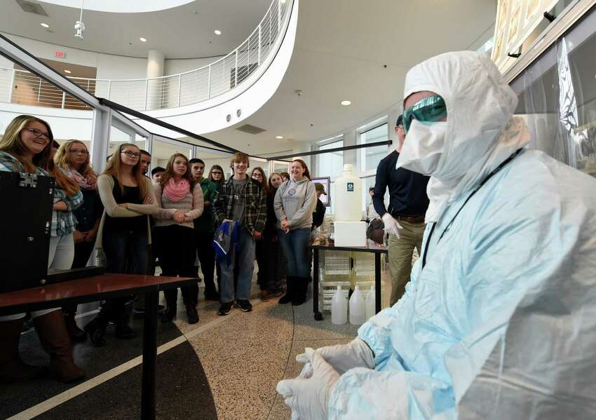 Northville High School junior Richard Arnold, right is all ready for a trip to the clean room at a nano fab on Nano Career Day at the SUNY Polytechnic Institute Wednesday morning Oct. 21, 2015 in Albany, N.Y. (Skip Dickstein/Times Union)