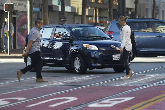 "A driver turns right onto Market Street from northbound Sixth Street despite ""no right turn"" signs posted at the intersection in San Francisco, Calif. on Wednesday, Oct. 21, 2015."