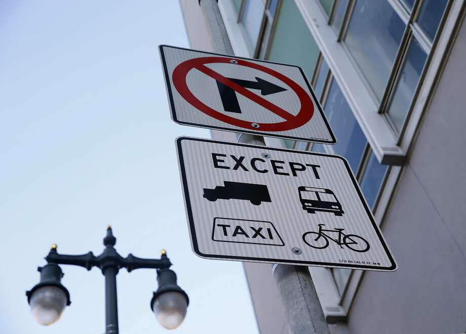 Traffic signs advise motorists of restrictions to access onto Market Street from Sixth Street in San Francisco, Calif. on Wednesday, Oct. 21, 2015. Photo: Paul Chinn, The Chronicle