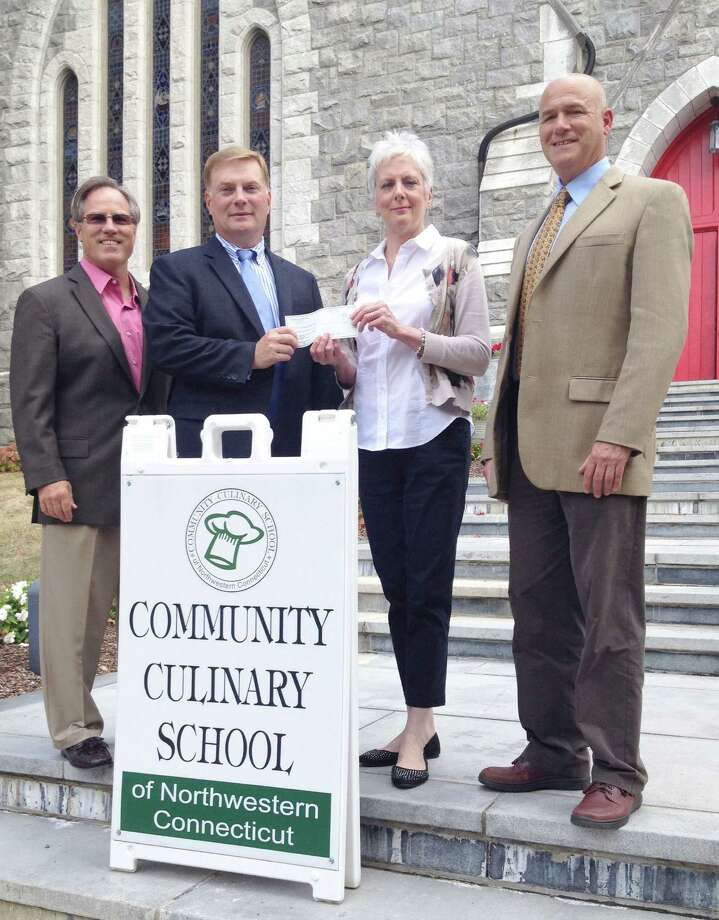 Supporting the culinary arts The Community Culinary School of Northwestern Connecticut based in New Milford was recently the beneficiary of a donation from Nicholas/Tobin & Associates totaling $6,200. The donation was raised at the 10th annual A Taste of New Milford held Sept. 9, 2015, on the Village Green in town. The Greater New Milford Chamber of Commerce event, which is sponsored and organized by Nicholas/Tobin & Associates Insurance, drew over 850 people to sample delicacies from over 30 restaurants, bakers and caterers. Local wineries and breweries were also in attendance. Above, Dawn Hammacott, executive director of the school, second from right, is presented by the check by, from left to right, Kyle Brady, regional sales representative at Nicholas/Tobin, Richard Herrington, president of Nicholas/Tobin, and Jeffrey Kilberg, vice president of Nicholas/Tobin. For more information about the school, call 203-512-5791 or visit www.communityculinaryschool.org. Photo: Courtesy Of The Community Culinary School Of Northwestern Connecticut / The News-Times Contributed