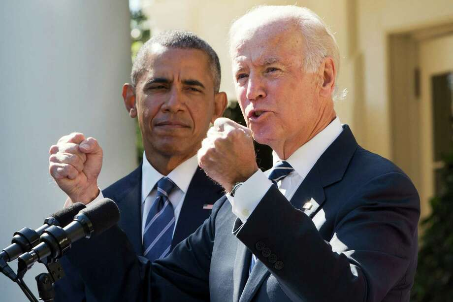 Vice President Joe Biden, with President Barack Obama, gestures as he speaks in the Rose Garden of the White House in Washington, Wednesday, Oct. 21, 2015, to announce that he will not run for the presidential nomination. Photo: Jacquelyn Martin, AP / AP