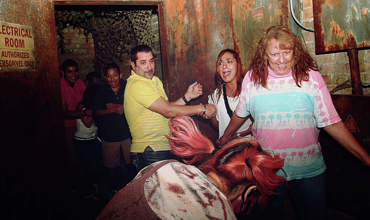 A hidden camera caught local scare-seekers laughing (and crying) in the face of death at the 13th Floor Haunted House in San Antonio.