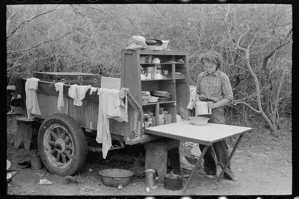 Two-wheeled trailer with kitchen cabinet fitted on the end. This is copied from the old chuck wagons. Harlingen, Texas migrant camp