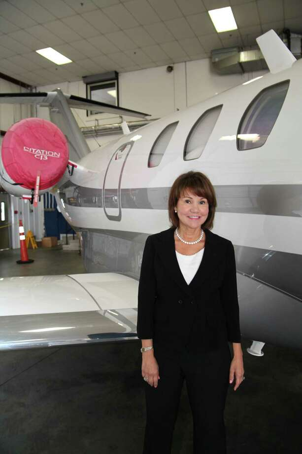 Millie Hernandez-Becker is pictured in the corporate and privately operated hangars of the Westchester County Airport. Photo: John Golden For Westfair/Contrib / John Golden/Contributed Photo / Westfair/ Greenwich Time Contributed