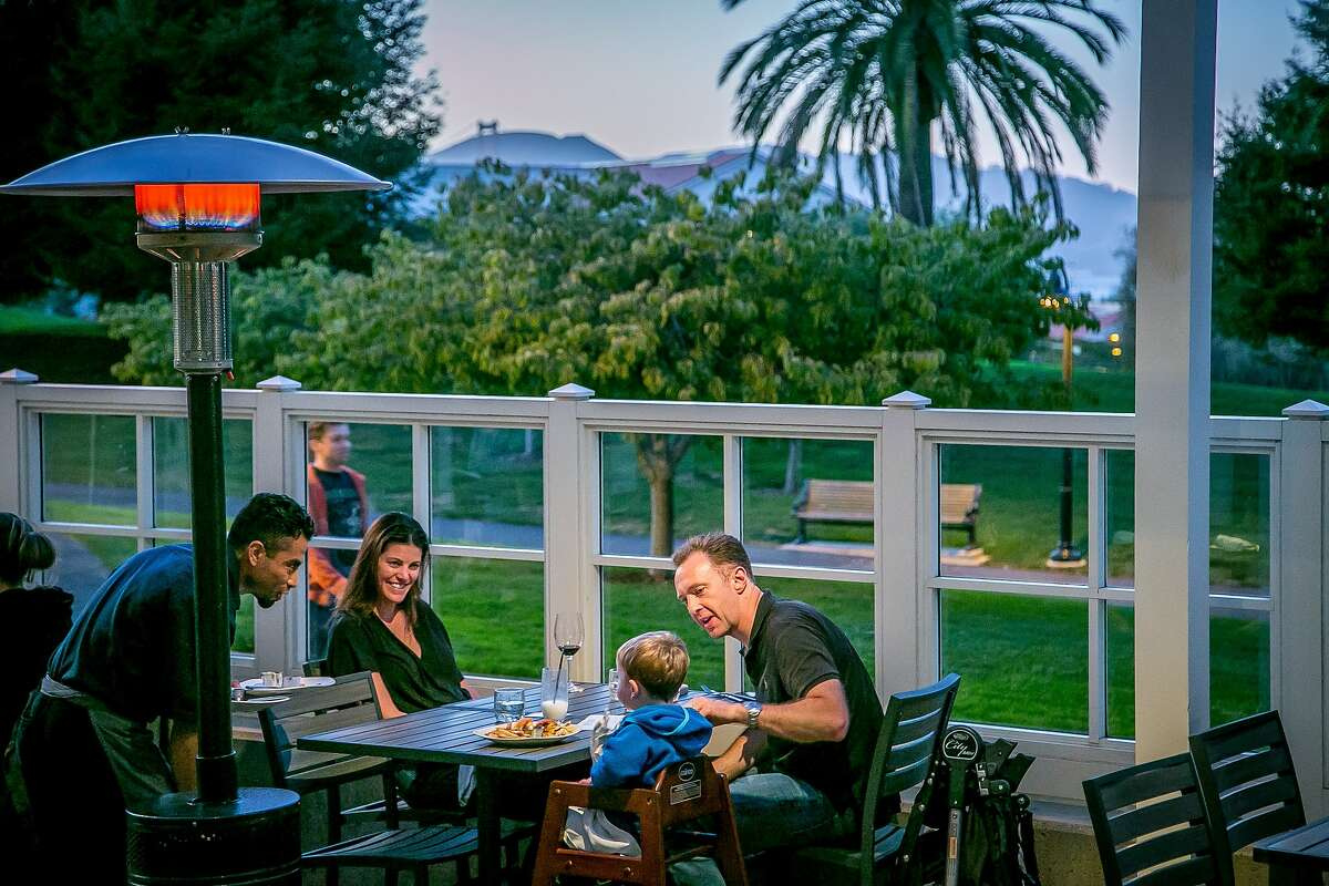 A family has dinner on the patio at Sessions at the Presidio restaurant in San Francisco, Calif. on Tuesday, October 20th, 2015.