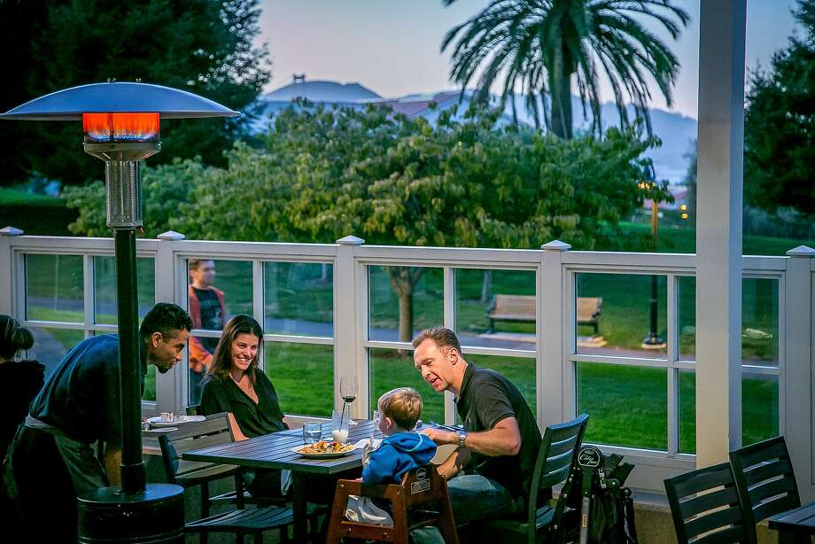 A family dines on the patio at Sessions at the Presidio. Photo: John Storey, Special To The Chronicle
