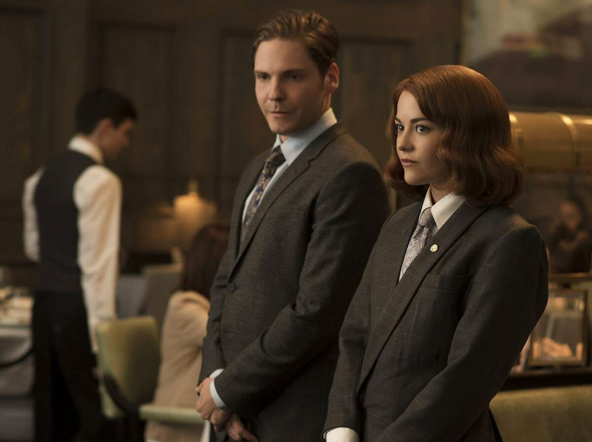 This photo provided by The Weinstein Company, shows Daniel Bruhl, left, as Tony and Sarah Greene as Kaitlin in a scene from the film,