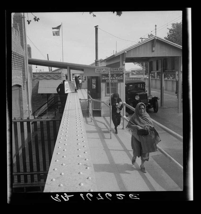 Crossing the international bridge between Juarez, Mexico and El Paso, Texas, May 1937.