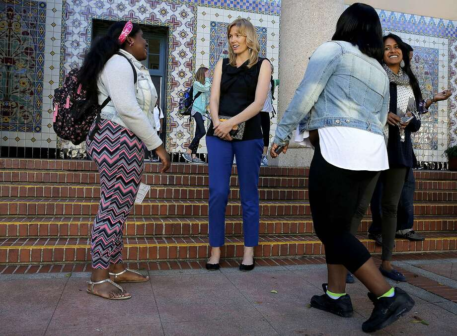 In this Oct. 19, 2015 photo, principal Lena Van Haren, center, speaks with former students Kayla Rash, left, and Honesty Williams outside Everett Middle School in San Francisco. A student election at a mostly black and Hispanic middle school turned into a fierce debate about the democratic process when the school's principal delayed announcing the election results over concerns they did not reflect the school's diverse student body. (Connor Radnovich/San Francisco Chronicle via AP) MANDATORY CREDIT FOR PHOTOGRAPHER AND SF CHRONICLE; NO SALES; MAGS OUT; TV OUT; Photo: Connor Radnovich, Associated Press