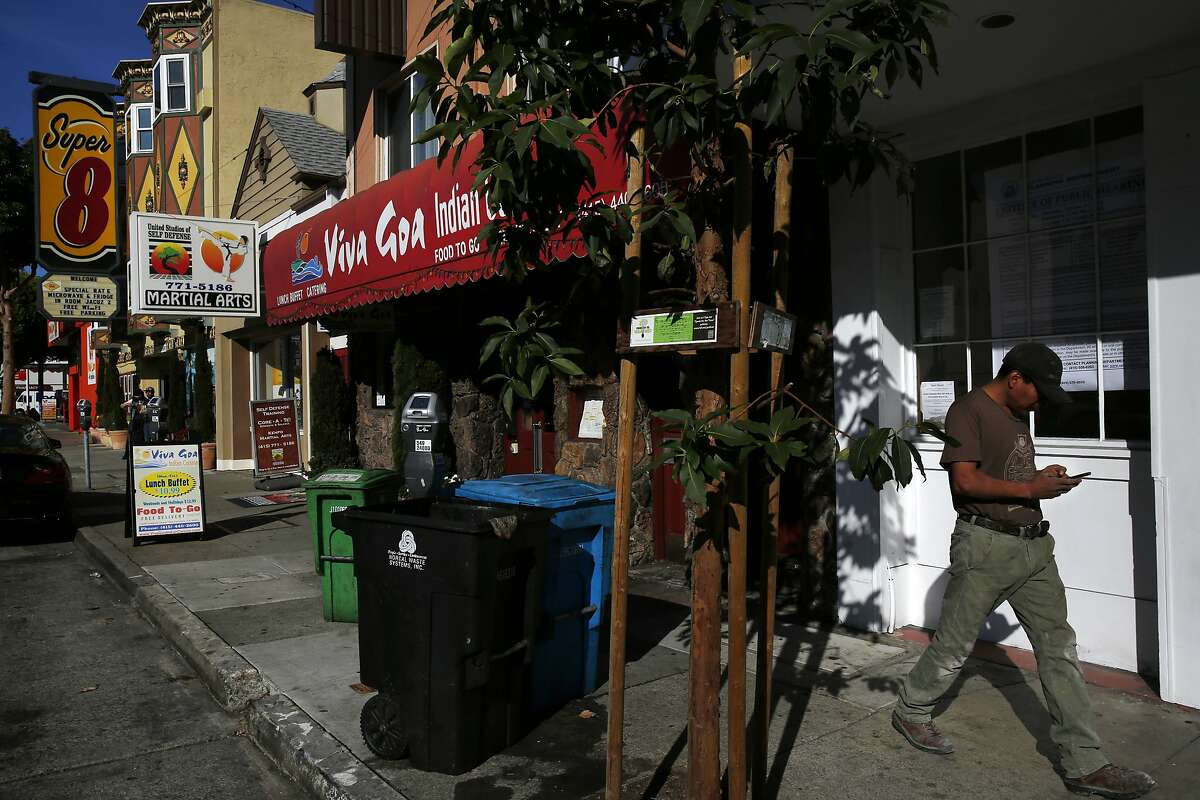 A pedestrian walks past the proposed future site for a new medical cannabis dispensary called The Apothecarium off of Lombard Street Oct. 20, 2015 in San Francisco, Calif.
