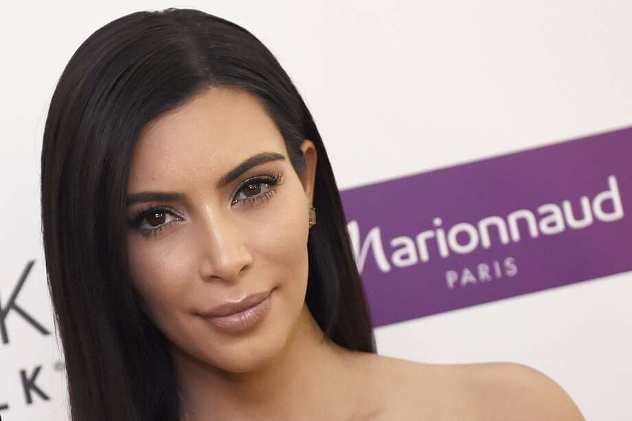 PHOTOS: Kim Kardashian: 35 looks for her 35th birthdayUS reality TV star Kim Kardashian poses while presenting a product of her new comestic brand during a photocall, on April 15, 2015 in Paris. (LOIC VENANCE/AFP/Getty Images)