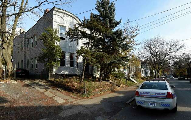 An Albany police car sits outside 461 Hamilton Street at the scene of an alleged underage drinking party Tuesday afternoon, Nov. 18, 2014 in Albany, N.Y.  Police responded to a call early Sunday morning and found five intoxicated 19-year-old men, all University at Albany students. One of them, Trevor Duffy, 19, of Bronx, died at Albany Medical Center after excessive alcohol consumption. (Skip Dickstein/Times Union) Photo: SKIP DICKSTEIN / 00029538A