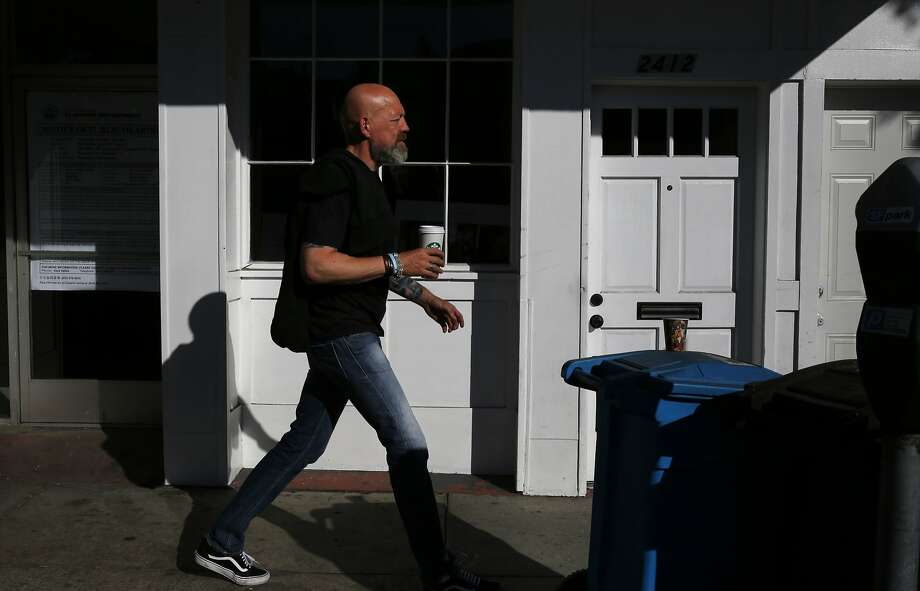 A pedestrian walks past the proposed future site for a new medical cannabis dispensary called The Apothecarium off of Lombard Street Oct. 20, 2015 in San Francisco, Calif. Photo: Leah Millis, The Chronicle