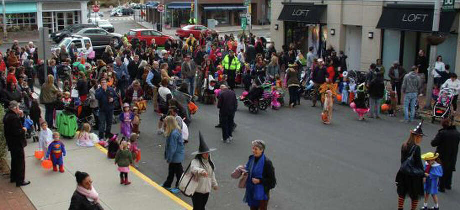Poised for treat-or-treating at a recent Halloween parade through downtown, the crowd will gather again Oct. 28 for the annual holiday event. Photo: File Photo / Westport News