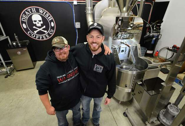 Death Wish Coffee Company research and development head, John Swedish, left, and company owner Michael Brown, right, stand next to the coffee roaster at their production facility Thursday, Oct. 15, 2015, in Round Lake, N.Y. (Will Waldron/Times Union) Photo: Will Waldron / 10033769A