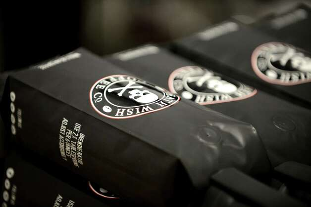 Packages of Death Wish Coffee are displayed Thursday, Oct. 15, 2015, at the Death Wish Coffee Company facility in Round Lake, N.Y. Death Wish sells a strong coffee that is high in caffeine. (Will Waldron/Times Union) Photo: Will Waldron / 10033769A