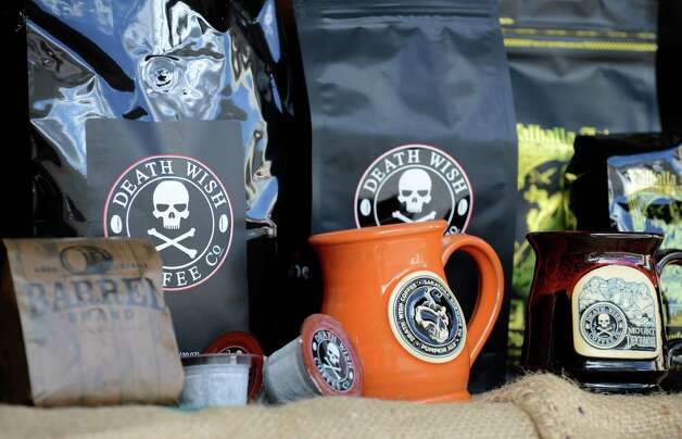 Death Wish Coffee Company products are displayed at their production facility Thursday, Oct. 15, 2015, in Round Lake, N.Y. Death Wish sells a strong coffee that is high in caffeine. (Will Waldron/Times Union) Photo: Will Waldron / 10033769A