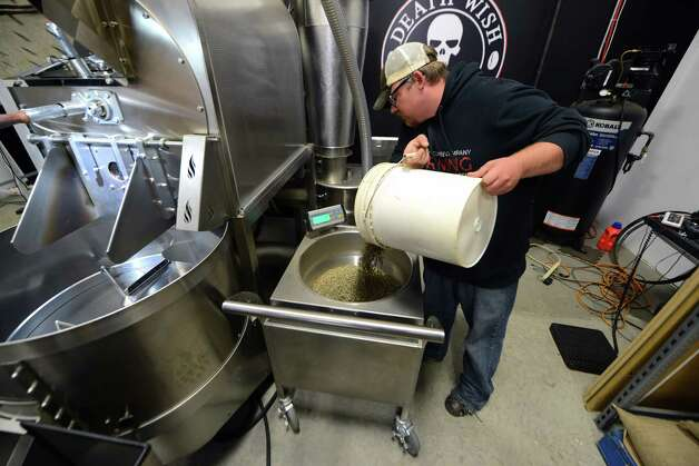 Death Wish Coffee Company research and development head, John Swedish loads coffee beans into the roaster Thursday, Oct. 15, 2015, at the Death Wish Coffee Company facility in Round Lake, N.Y. Death Wish sells a strong coffee that is high in caffeine. (Will Waldron/Times Union) Photo: Will Waldron / 10033769A