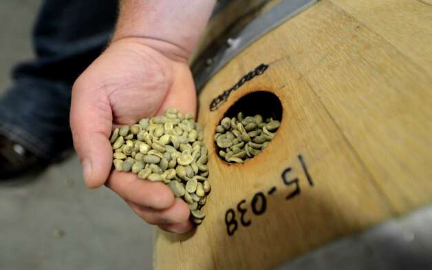 Rum barrels are filled with coffee beans for flavor infusion Thursday, Oct. 15, 2015, at the Death Wish Coffee Company facility in Round Lake, N.Y. Death Wish sells a strong coffee that is high in caffeine. (Will Waldron/Times Union) Photo: Will Waldron / 10033769A