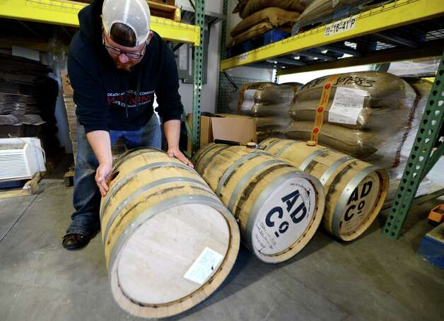 Death Wish Coffee Company research and development head, John Swedish displays rum barrels that are filled with coffee beans for flavor infusion Thursday, Oct. 15, 2015, at the Death Wish Coffee Company facility in Round Lake, N.Y. Death Wish sells a strong coffee that is high in caffeine. (Will Waldron/Times Union) Photo: Will Waldron / 10033769A