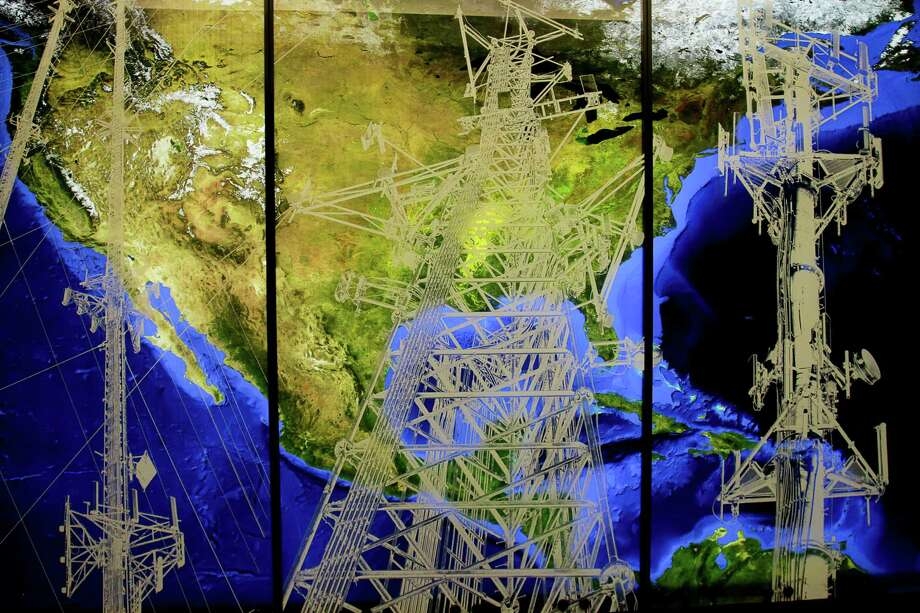 This commissioned artwork by Joe Aker, is at the entrance to Crown Castle offices at 1220 Augusta Drive. Crown Castle is the nation's largest provider of wireless infrastructure.  (For the Chronicle/Gary Fountain, June 5, 2015) Photo: Gary Fountain, Freelance / Copyright 2015 by Gary Fountain